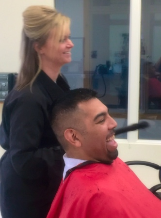 Laughing while getting a haircut